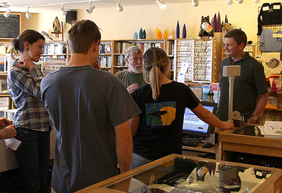Interns Claire, Nick, Nora, and Executive Director Geoff visit with Gary in the bookstore.