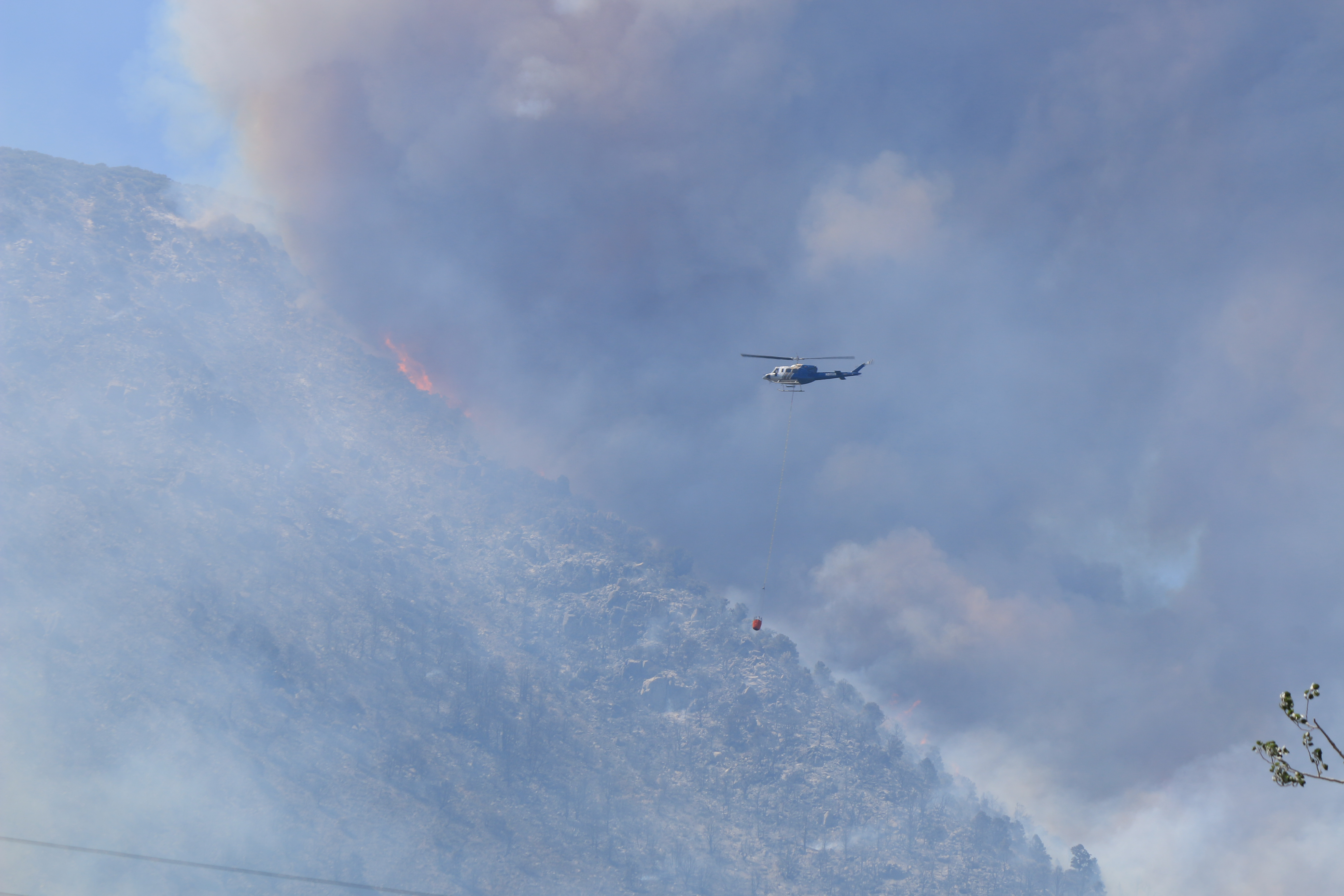 At times there have been four helicopters working on the Marina Fire and scooping water from Mono Lake. Photo by Bartshe Miller.