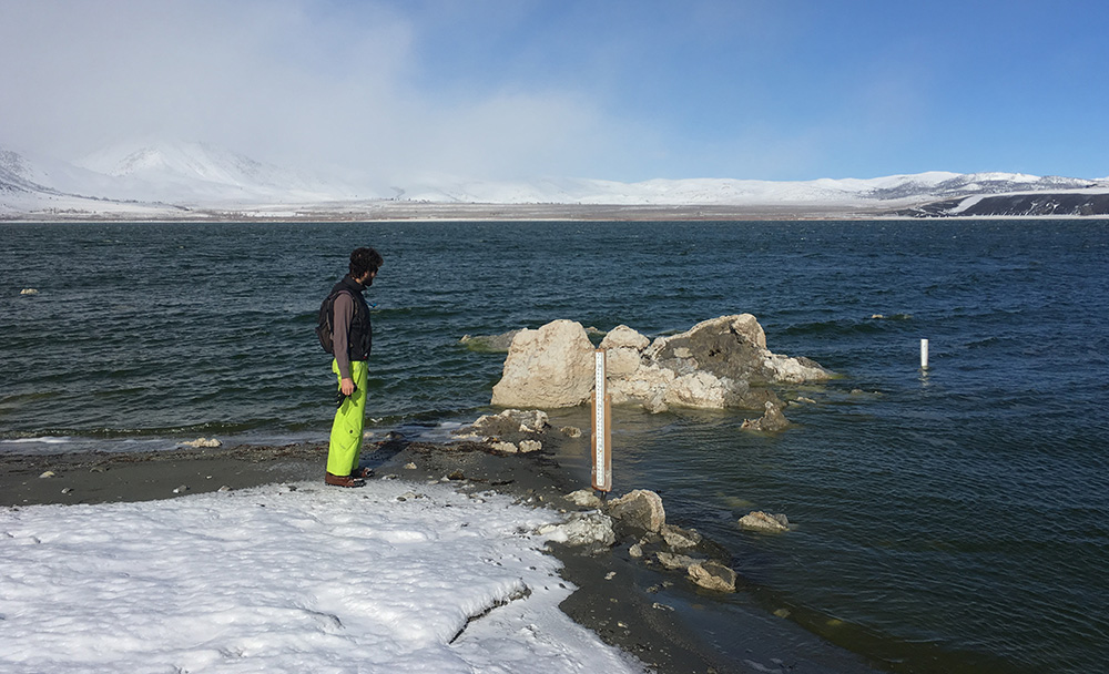 Robbie checks out the lake level gauge. Mono Lake rose about six inches last week, to 6377.5 feet above sea level. Photo by Andrew Youssef.