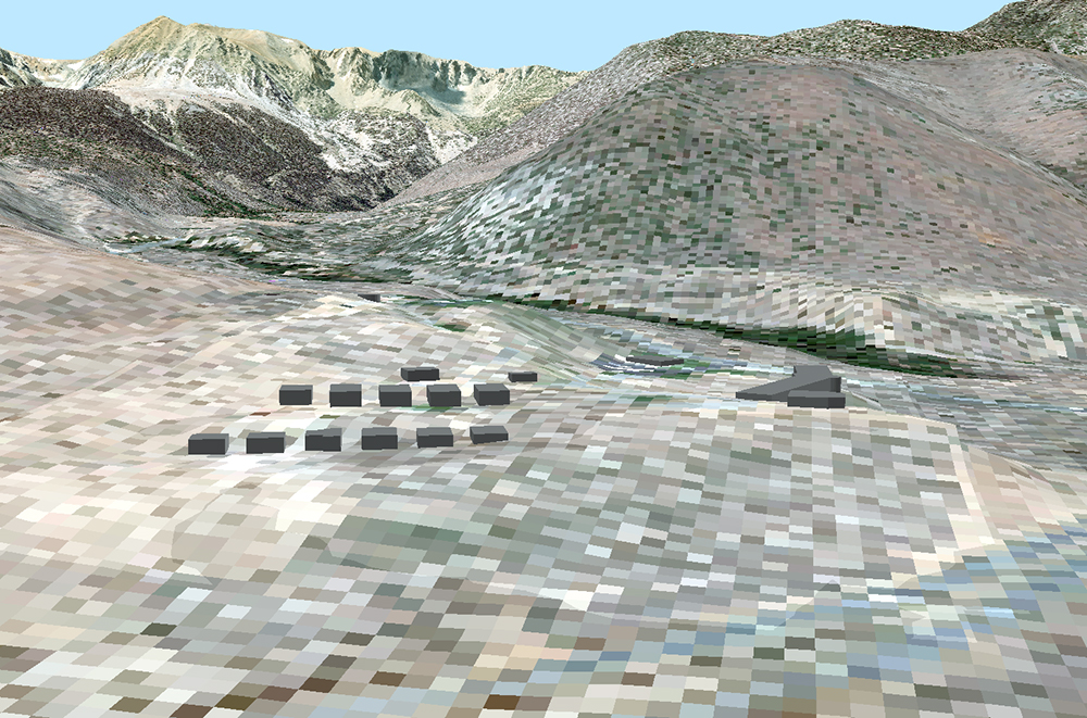 A mountainous landscape is made up of pixilated squares of different shades of green and brown. Several dark gray cube structures sit in the valley.