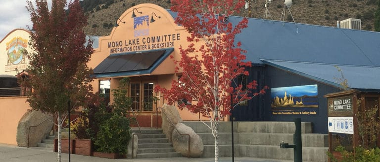Mono Lake Committee Information Center & Bookstore storefront with trees with fall colors out front.